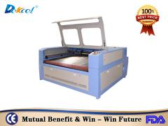 Dekcelcnc® China Automatic Feeding 100w Co2 Laser Cutter Leather/ Fabric pric